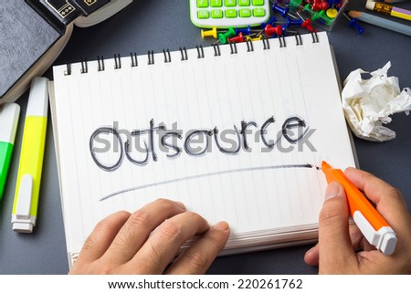 Handwriting of Outsource word in notebook on the desk - stock photo