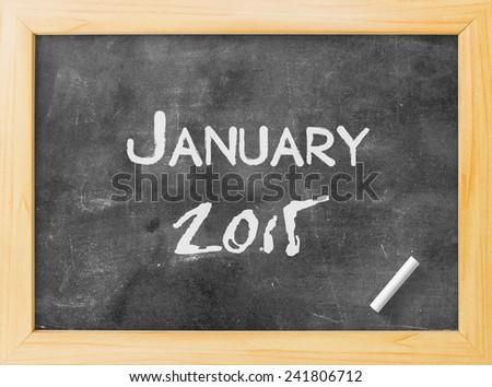Handwriting text for JANUARY 2015 on blackboard. - stock photo