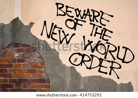 Handwritten graffiti Beware Of The New World Order sprayed on the wall, anarchist aesthetics. Caution on conspiracy theory about secret totalitarian world government  - stock photo