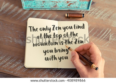 Handwritten quote The only Zen you find at the top of the mountain is the Zen you bring with you - stock photo