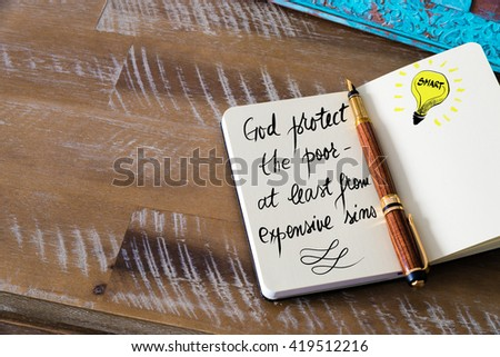 Handwritten text God protect the poor â?? at least from expensive sins with fountain pen on notebook. Concept image with copy space available. - stock photo