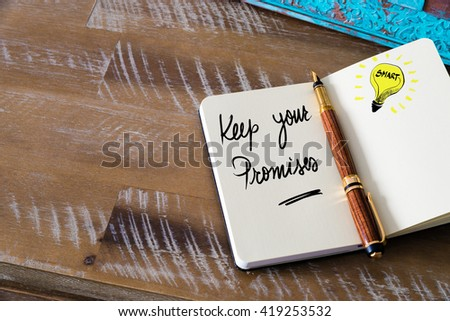 Handwritten text Keep Your Promises with fountain pen on notebook. Concept image with copy space available. - stock photo