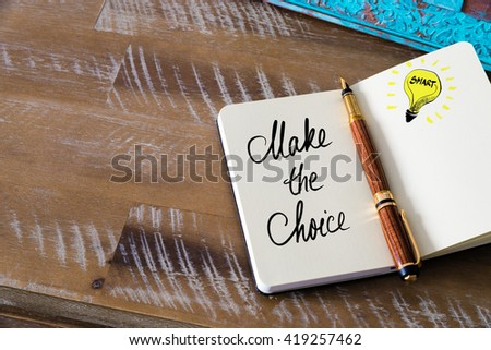 Handwritten text Make The Choice with fountain pen on notebook. Concept image with copy space available. - stock photo