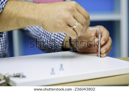 Handyman - DIY, a man with an allen key - stock photo