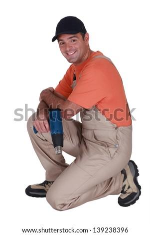 Handyman holding a screw gun - stock photo