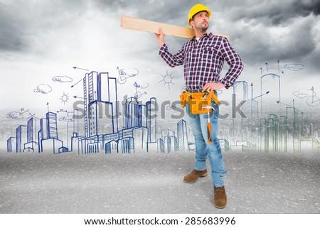 Handyman holding wood planks against road - stock photo