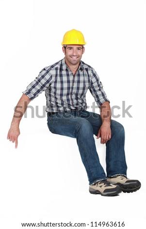 Handyman pointing downwards - stock photo