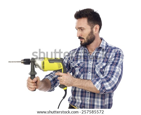 Handyman using drill - stock photo