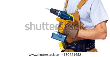 Handyman with a drill. House renovation service. - stock photo