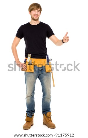Handyman with thumbs up - stock photo
