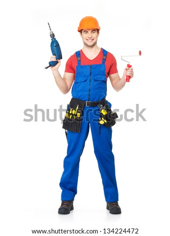 Handyman with tool drill and brush  full portrait over white background - stock photo