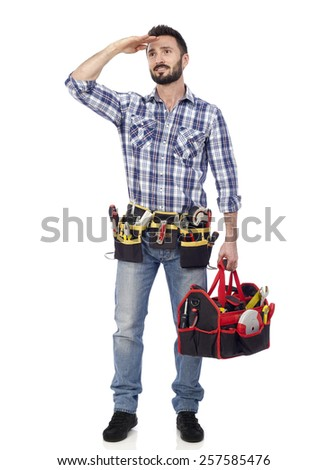 Handyman with toolbox looking into the distance - stock photo