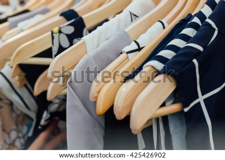hang cloths in Clothing Store for sale - stock photo
