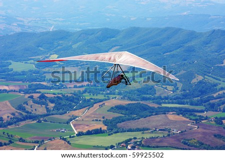 hang-glider taking of in the flight taken in Italy, Monte Cucco - stock photo