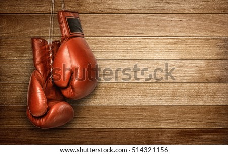 Boxing Gloves Hanging On Wooden Wall Stock Photo 218658337