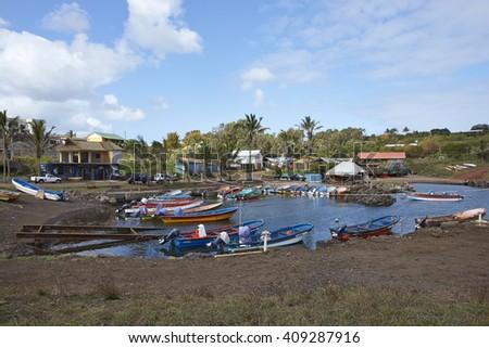 HANGA ROA, EASTER ISLAND, CHILE - APRIL 6, 2016: Fishing boats in a small harbour in HANGA ROA, capital of Easter Island.  - stock photo