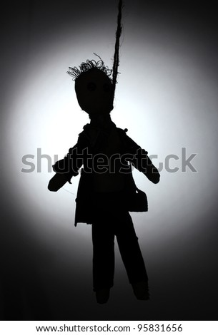 Hanged doll voodoo boy-groom on grey background - stock photo