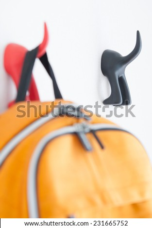 hanger with bagpack  - stock photo