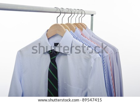 hanger with shirts and necktie isolated on white background - stock photo