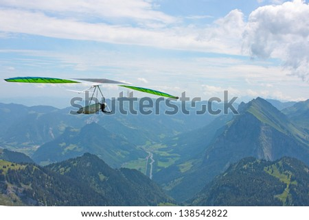 Hanggliding in Swiss Alps - stock photo