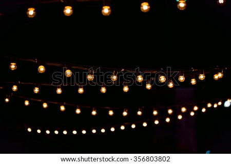 Hanging antique edison style filament light bulb - stock photo