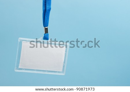 Hanging blank business plastic badge with blue neck strap and copy space