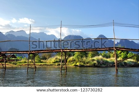 hanging bridge over the  Song river at Vang Vieng, Laos - stock photo