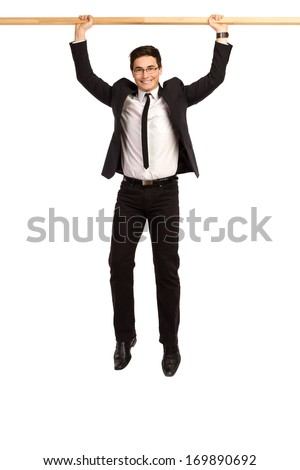 Hanging businessman. Full length studio shot isolated on white.