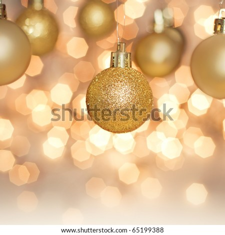 hanging Christmas decoration on gold background - stock photo