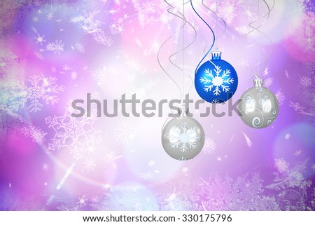 Hanging christmas decorations against christmas theme background