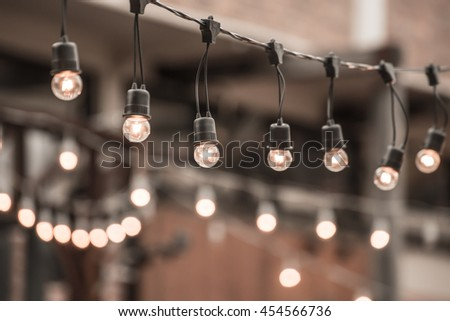 Hanging christmas lights for decoration - stock photo