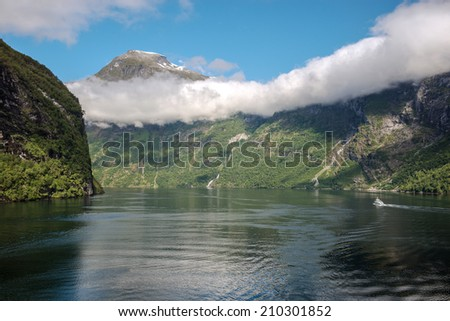 Hanging cloud bank in the beautiful Geiranger Fiord, Norway - stock photo