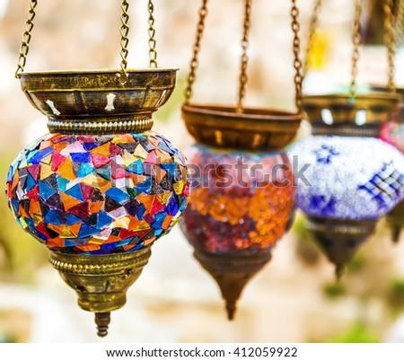 Hanging colorful arabic lamps illuminated islamic - stock photo