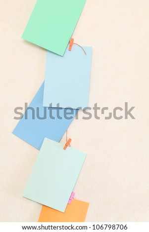 Hanging colorful paper with clothespins