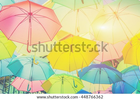 Hanging colorful umbrellas, on the street and blue sky.selective focus,vintage color - stock photo