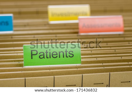 Hanging file folder labeled with Patients - stock photo
