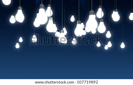 Hanging glowing light bulbs on blue background - stock photo