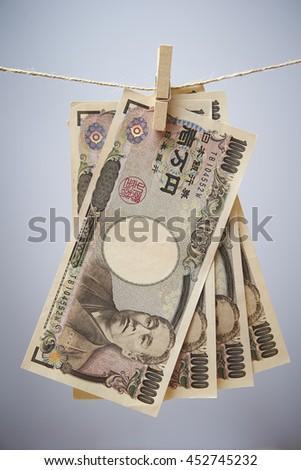 Hanging Japanese yen bills - stock photo