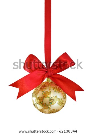 Hanging on a ribbon golden ornate Christmas bauble with red satin bow isolated on white