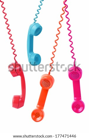 Hanging Phone with cable Receivers on White Background - stock photo