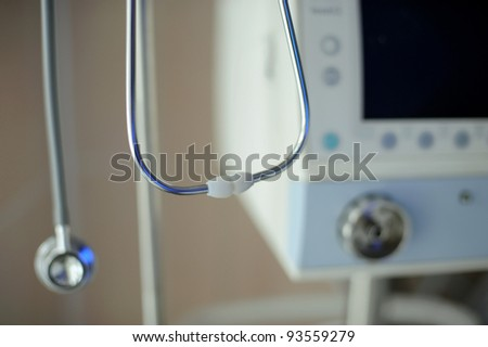 Hanging phonendoscope at maternity clinic - stock photo