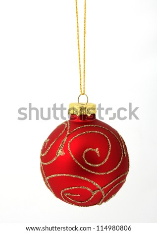 Hanging red glass ball on the white background - stock photo