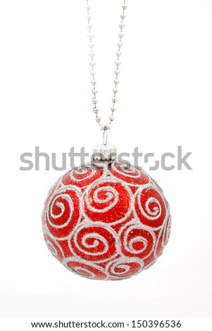 Hanging red glass balls on the white background - stock photo