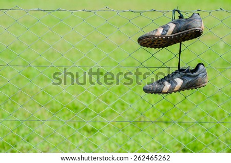 Hanging up his boots - stock photo