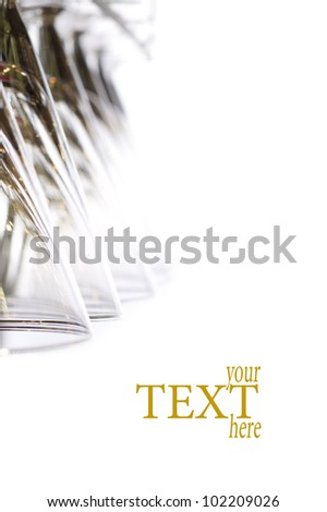 hanging wineglass, selective focus, color reflections, bokeh - stock photo