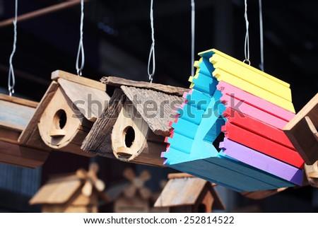 hanging wooden bird house - stock photo