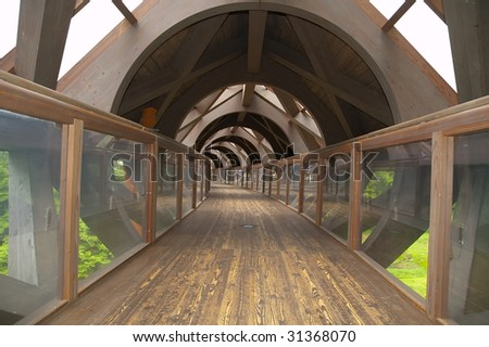 hanging wooden pedestrian tunnel in japan,Ninohe town. - stock photo