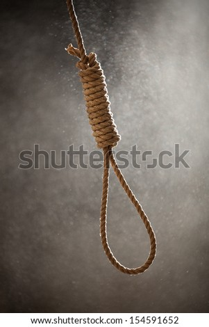 Hangman Noose with thirteen loops on a dusty background ready to be used - stock photo