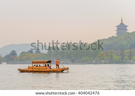 HANGZHOU, CHINA - APR 2, 2016: Traditional Chinese boat at the West Lake (Xi hu lake) is a freshwater lake in Hangzhou. UNESCO World Heritage Site