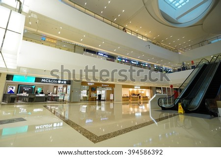 Hangzhou.China-MAR 21, 2016: Modern shopping mall interior.Multi luxury brand inside.In Hangzhou city of China. - stock photo